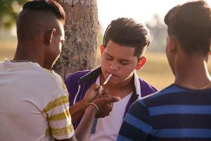 Group Of Teenagers Smoking Cigarette