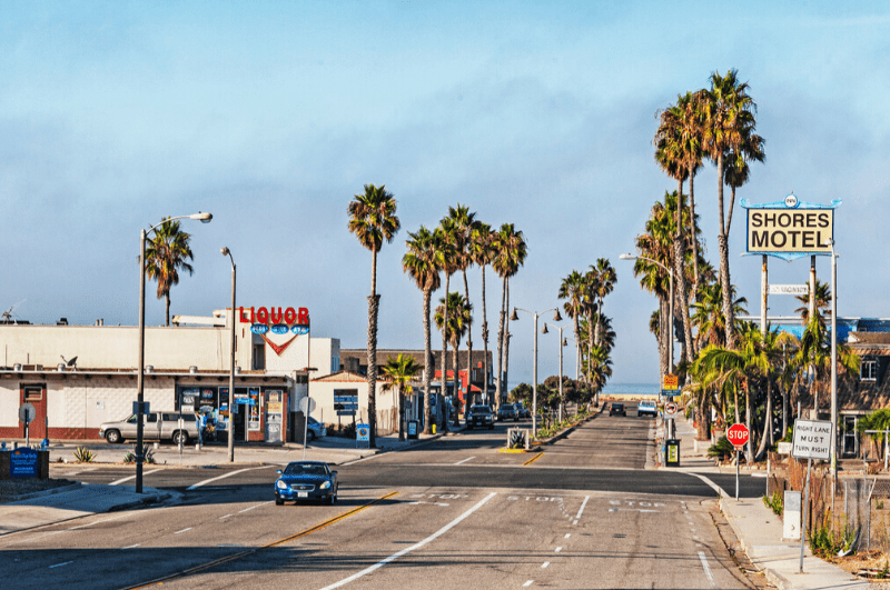 Ventura street with Shores Motel and a liquor store in the background